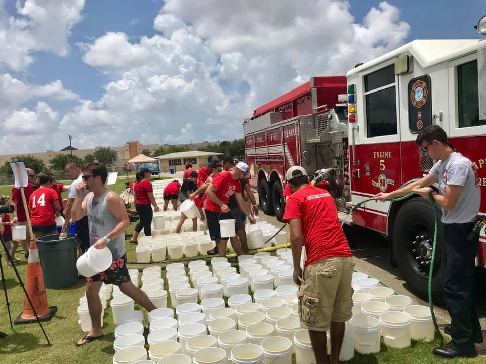Hundreds gather to take Ice Bucket Challenge, send message