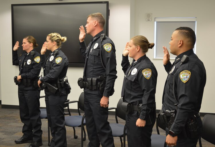Ceremony Held For New Promotions, New Officers