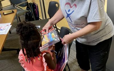 Guardian ad Litem Foundation hosts 'Back to School with the Blue' backpack giveaway