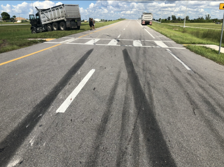 Driver Fails to Yield Right of Way to Dump Truck